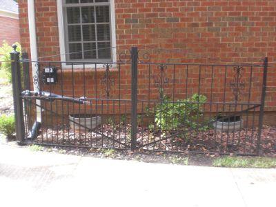 a broken driveway gate